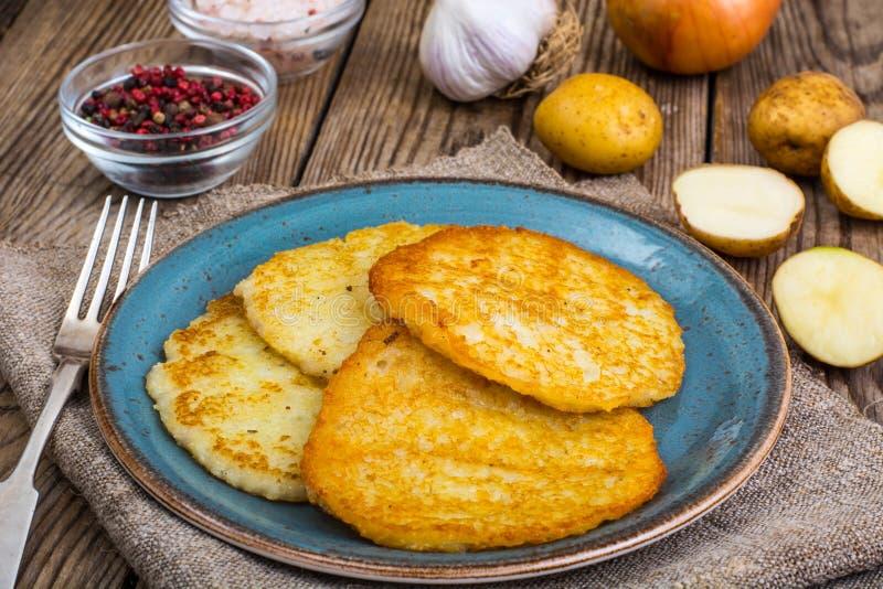 油煎的薄煎饼土豆 免版税库存图片
