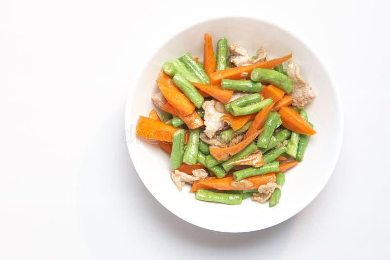油煎的Porki长的豆用红萝卜 免版税库存图片