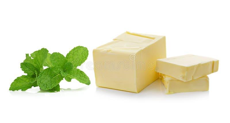 黄油薄菏和棍子在白色背景的 免版税库存图片