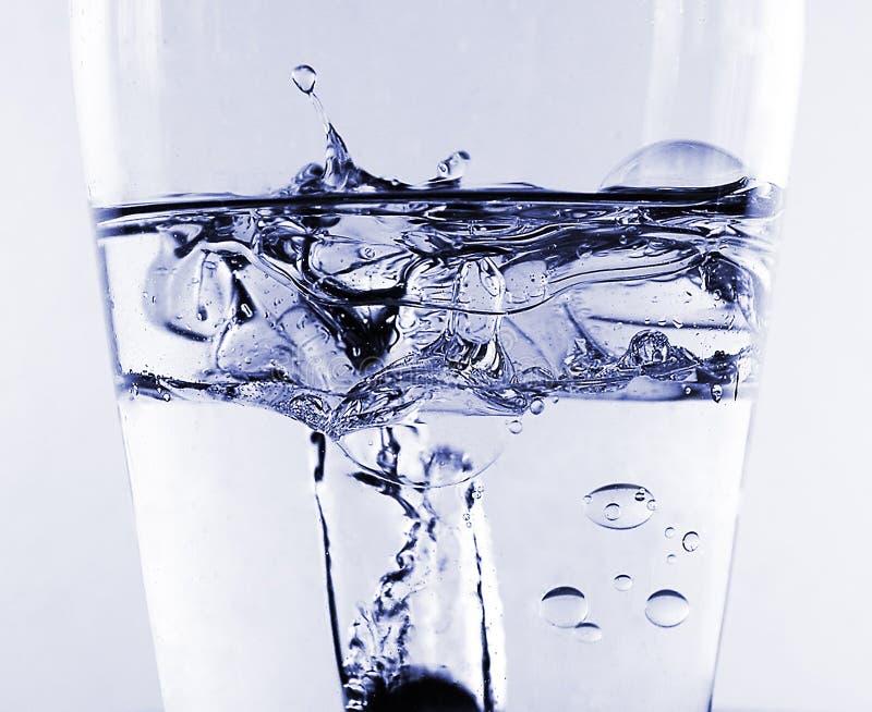 油飞溅水 免版税库存图片
