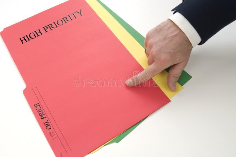 油价下落的特别优先权的红色文件 库存照片