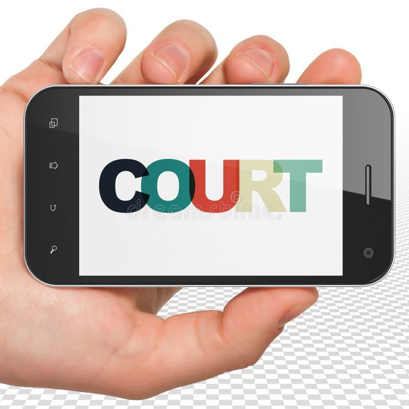 法律概念:拿着有法院的手智能手机在显示 皇族释放例证