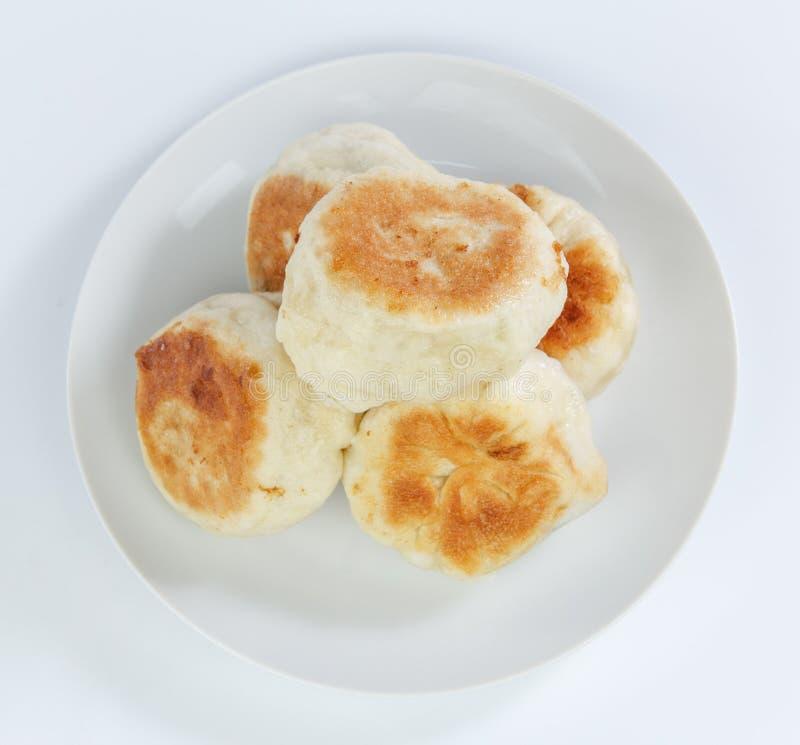 泛油煎的小圆面包 免版税库存图片