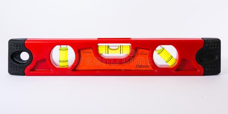 泡影水平仪建筑手工工具明亮的红色白色Backgorund 库存照片