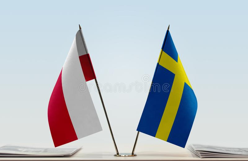 波兰和瑞典的旗子 库存图片