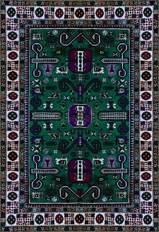 波斯地毯纹理,抽象装饰品 圆的坛场样式,东部传统地毯表面 绿松石绿色红色褐紫红色o 免版税库存图片