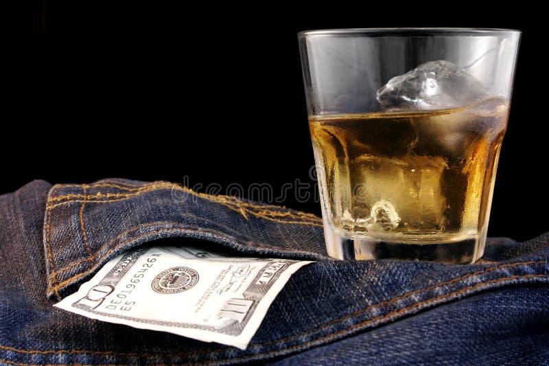 波旁酒牛仔布美元 免版税库存照片