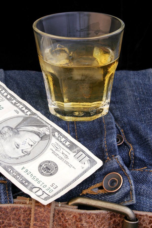 波旁酒牛仔布货币 免版税库存照片