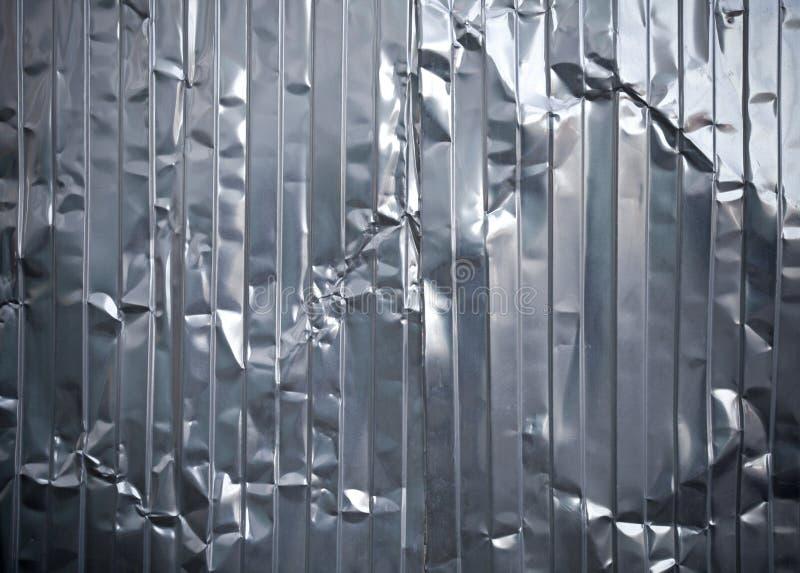 波纹状的金属弄皱的页纹理 图库摄影