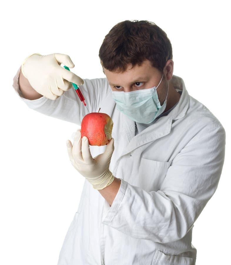 注射科学家的苹果化学制品 库存图片