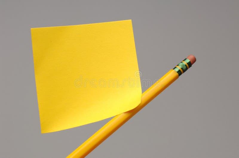 注意粘性铅笔 免版税图库摄影