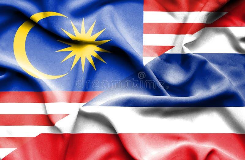 泰国和马来西亚的挥动的旗子 皇族释放例证