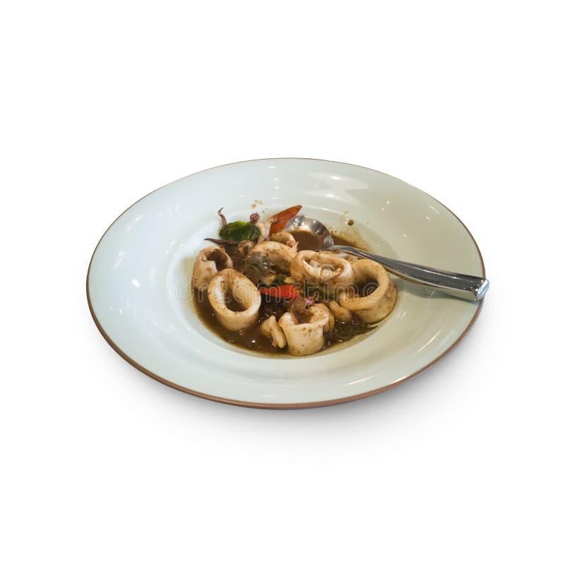 泰国著名食物:在白色的混乱油煎的海鲜乌贼孤立 免版税图库摄影