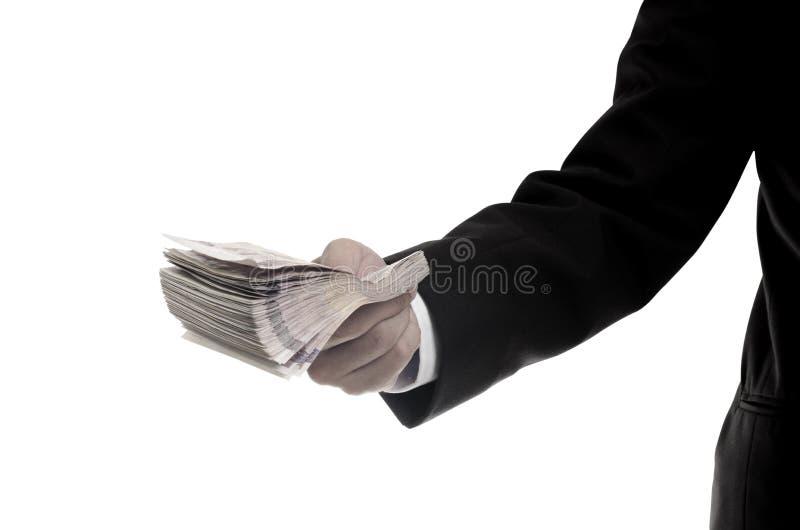 泰国金钱在手中,包括的裁减路线 库存图片