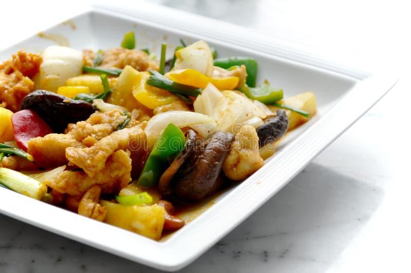 泰国食物-被搅动的菜和猪肉 免版税库存照片