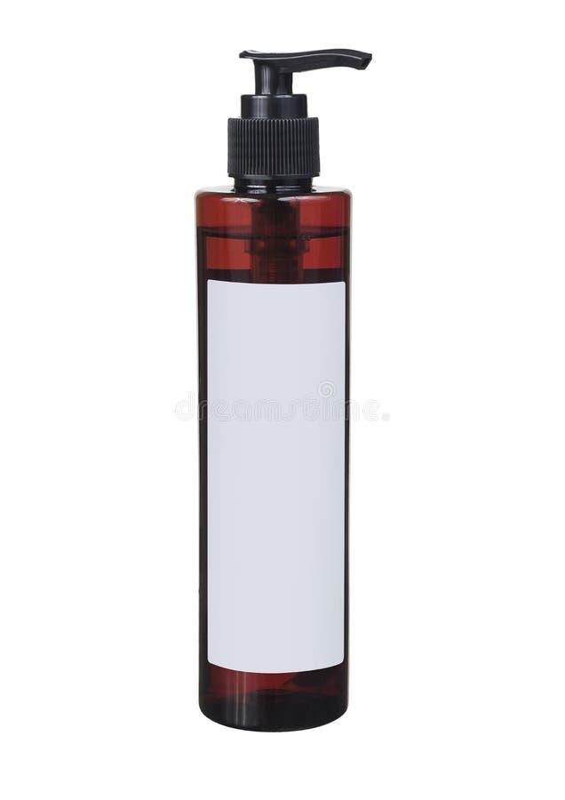 泵浦头褐色塑料瓶 免版税库存图片