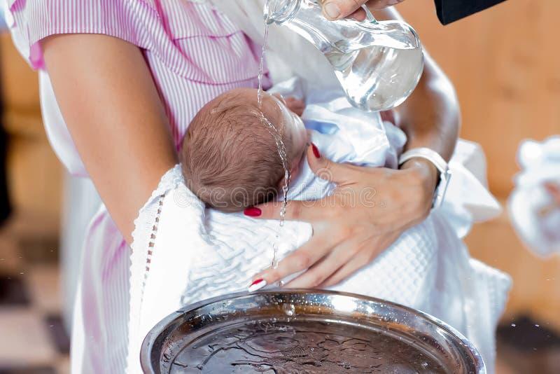洗礼仪式在教会,选择聚焦设置了 免版税图库摄影