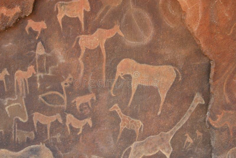 洞图画刻在岩石上的文字 免版税库存图片