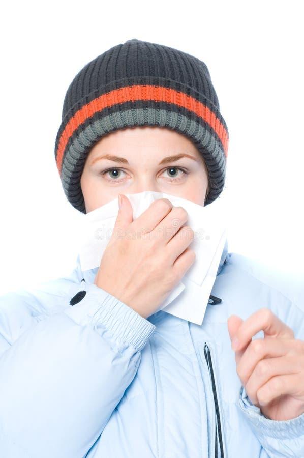 流感俏丽的喷嚏妇女 库存图片