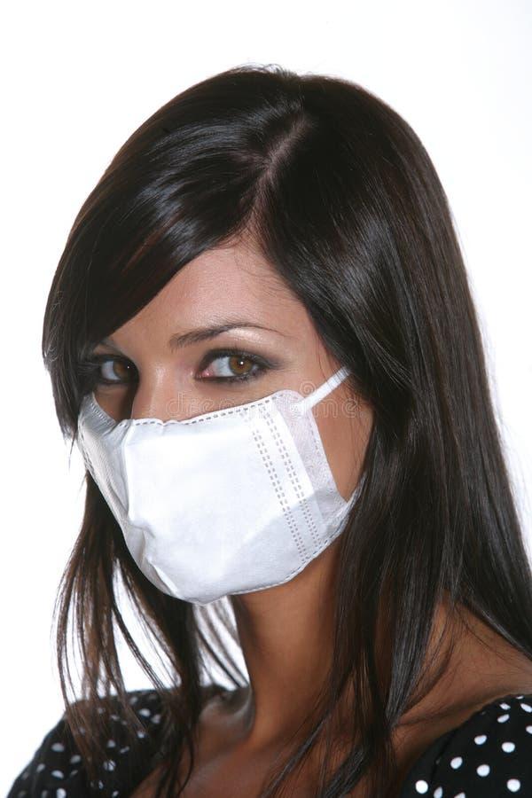 流感女孩屏蔽猪 图库摄影