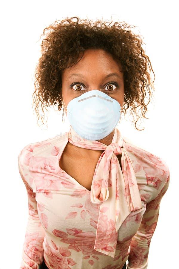 流感屏蔽佩带的妇女 免版税图库摄影