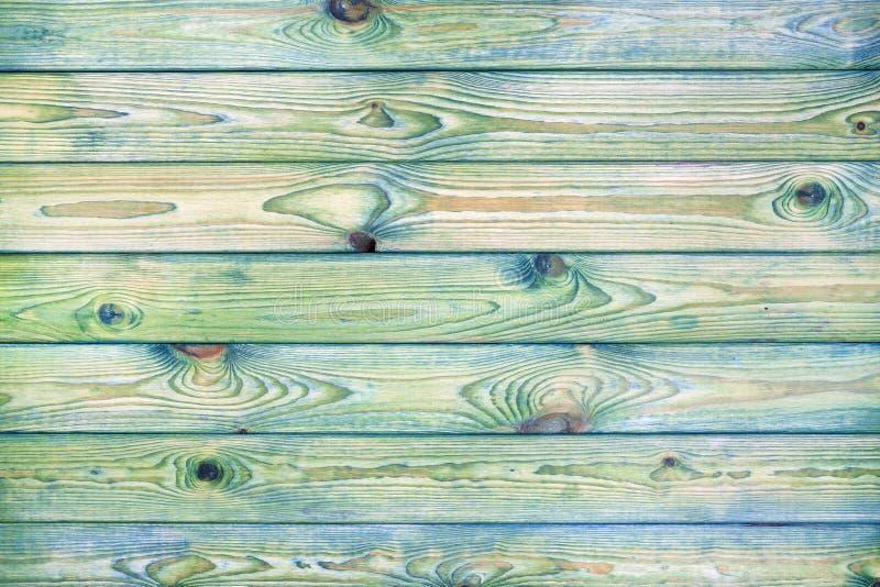 浅兰和绿色木背景 免版税库存图片