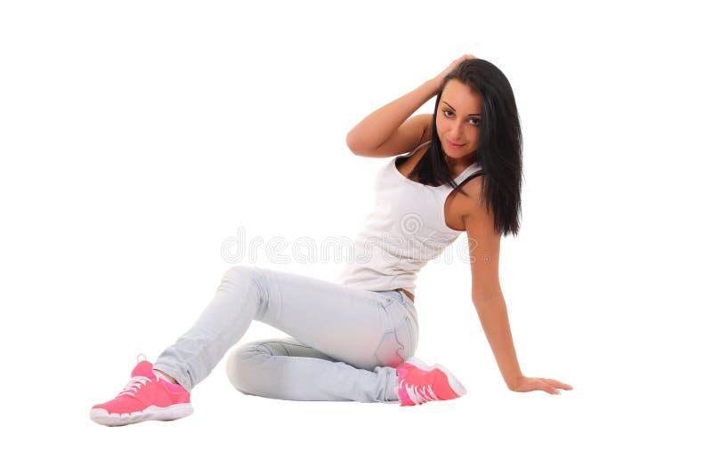 浅兰的牛仔裤的女孩 库存图片