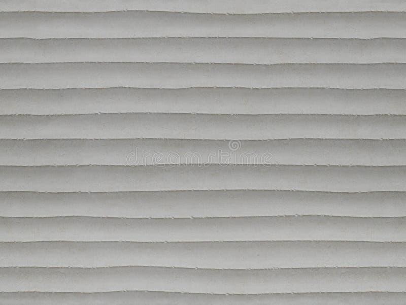 浅灰色的层状无缝的石纹理背景样式 与水平线的石无缝的纹理表面分层堆积 石头l 图库摄影