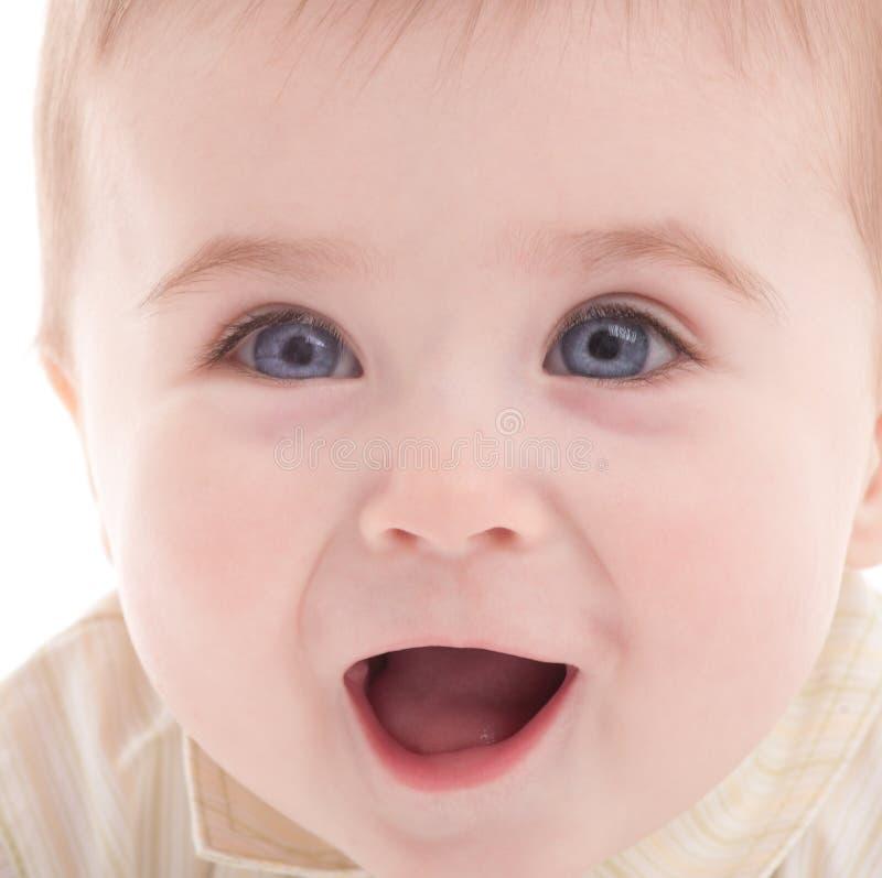 浅蓝色男孩注视快乐的纵向 库存照片