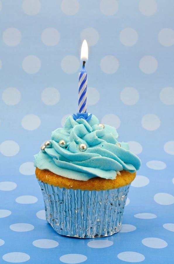 浅蓝色第一块生日杯形蛋糕 免版税图库摄影