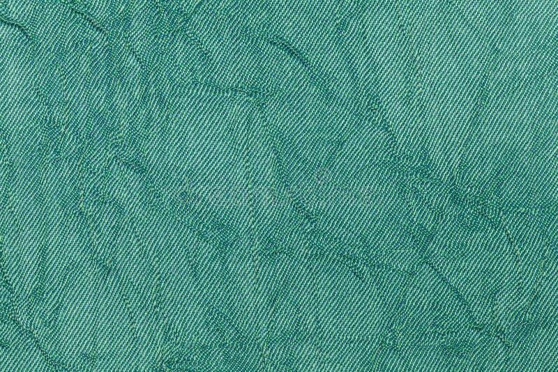 浅绿色的从纺织材料的珍珠波浪背景 与自然纹理特写镜头的织品 库存图片