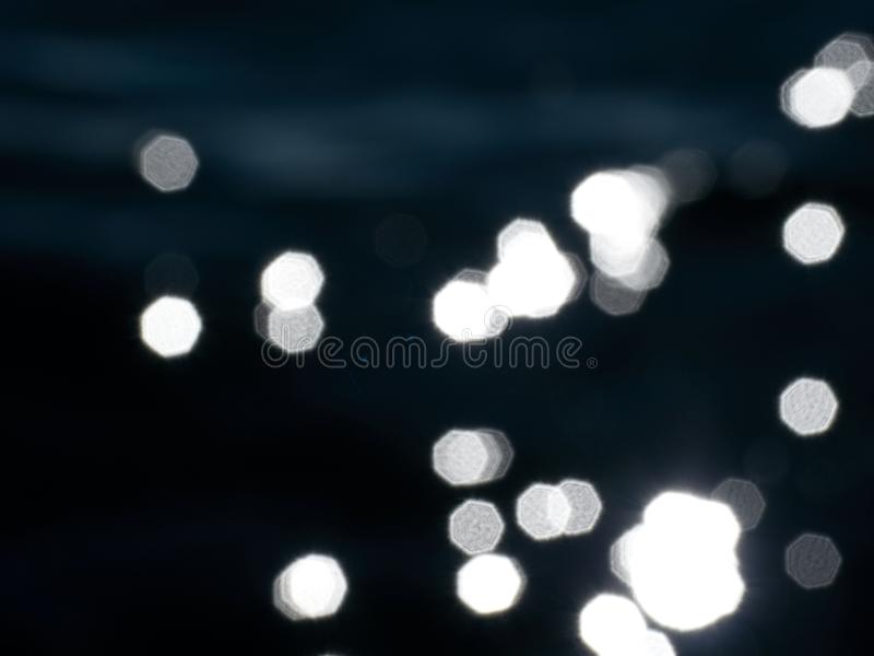 浇灌通过小的波浪,在移动与闪闪发光的阴影的水平面 库存图片