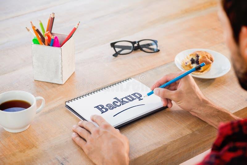 测试反对关于笔记本的创造性的商人文字笔记 库存照片