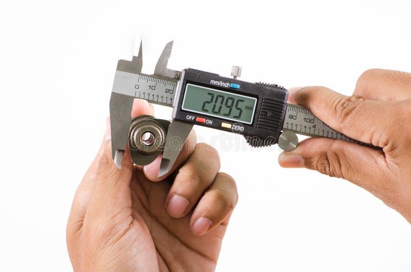测量大小的数字式游标卡尺 库存图片