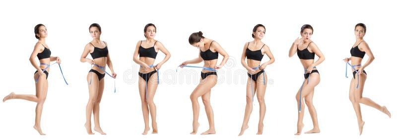 测量她的腰部的妇女由蓝色措施磁带 免版税图库摄影