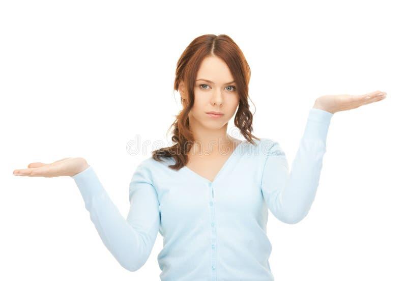 测量某事在她的手棕榈  免版税图库摄影