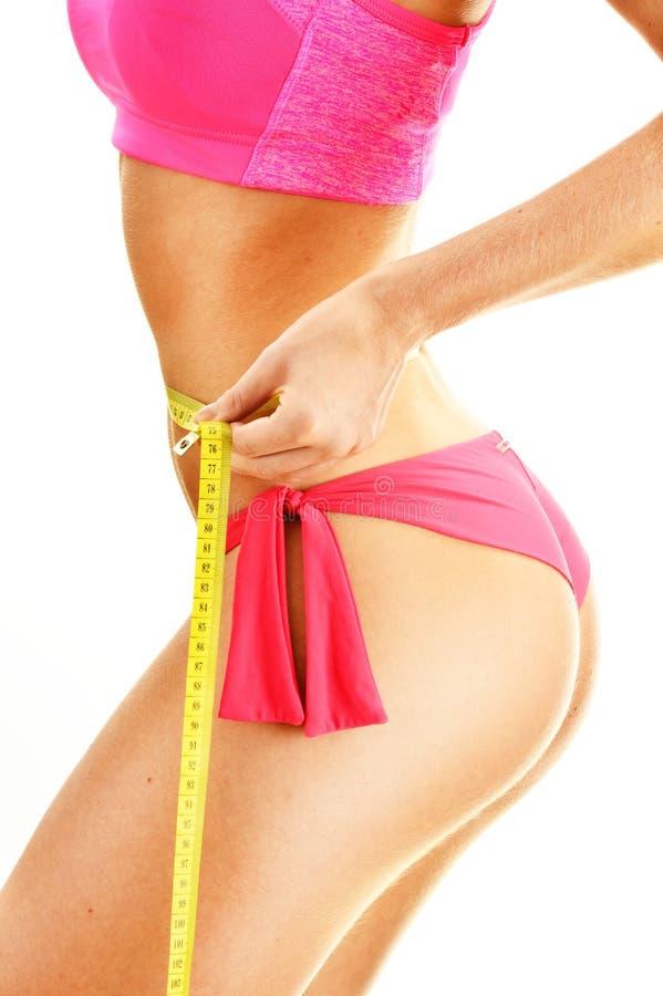 测量的性感的少妇 查出的损失评定躯干重量白人妇女 库存图片