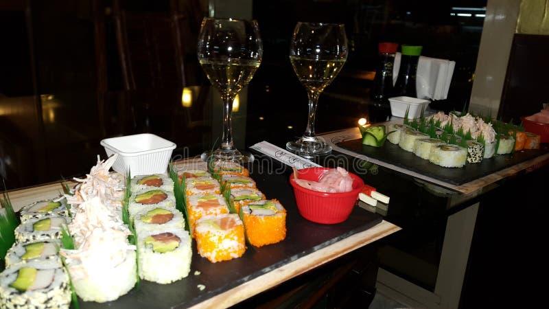 浪漫寿司&酒晚餐 库存图片