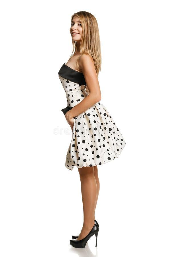 浪漫礼服的Flirty女孩 库存图片