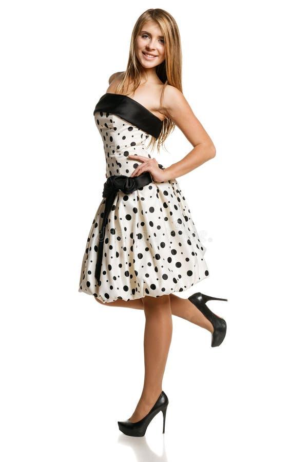 浪漫礼服的Flirty女孩 免版税库存图片