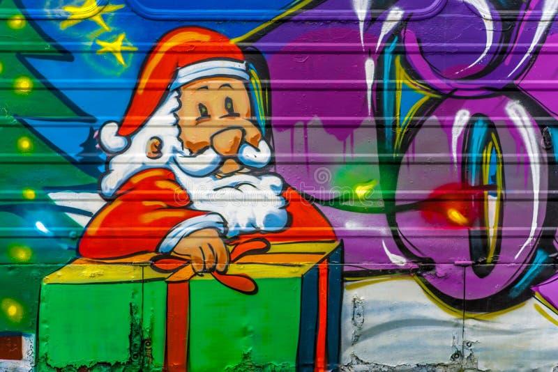 浪花被绘的圣诞老人 库存图片