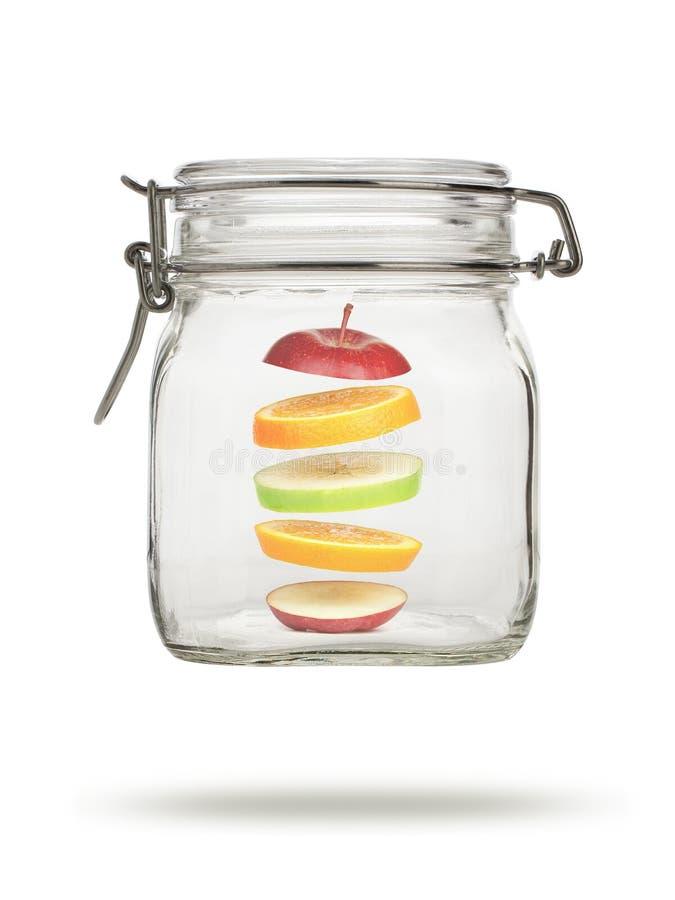 浮动果子玻璃的瓶子 免版税库存图片