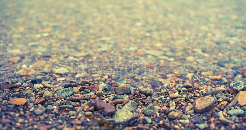 海小卵石装饰织地不很细背景横幅自然抽象背景  免版税库存照片