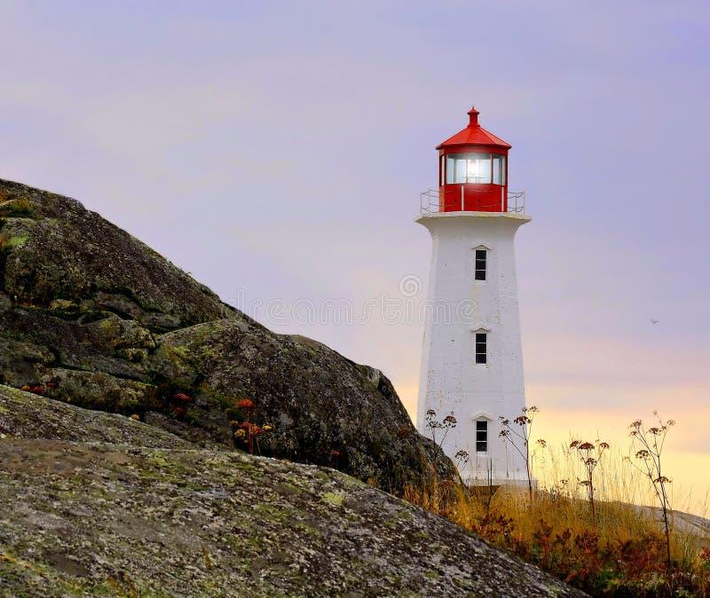 海岛灯塔在秋天 免版税库存照片