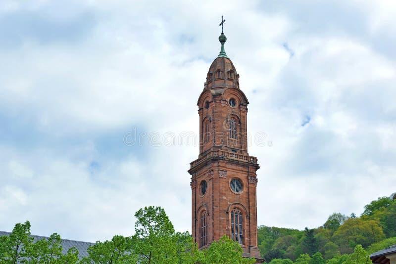 海得尔堡,德国-称'Jesuitenkirche的'老教会塔 库存图片
