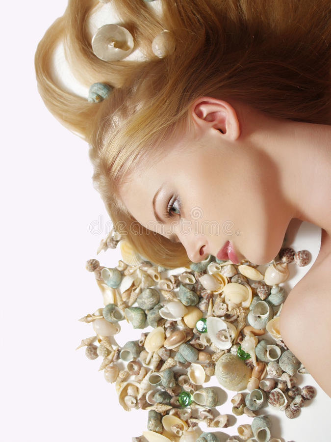 海扇壳头发她的妇女 免版税库存图片