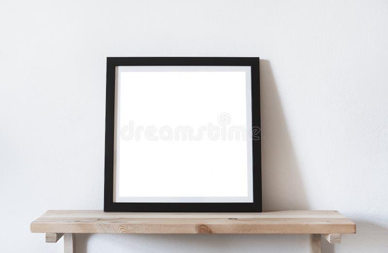 海报摆正在黑框架的格式在架子,客厅的白色时髦的现代内部 设计模板大模型 库存图片
