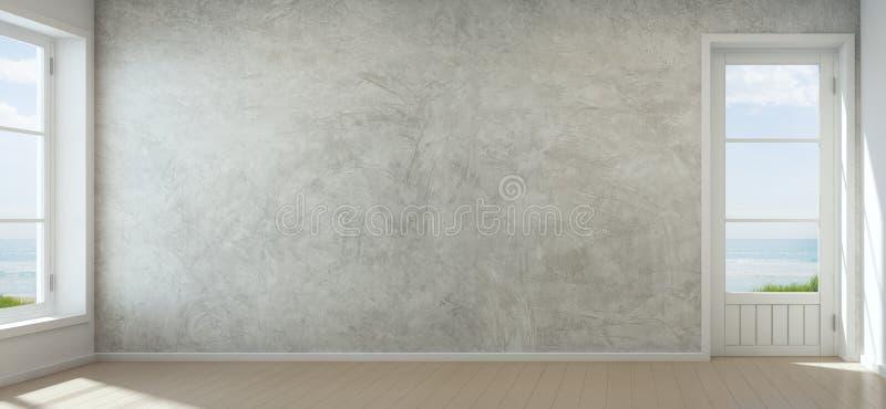 海有混凝土墙的视图室在现代海滨别墅,新的家空的内部里  图库摄影