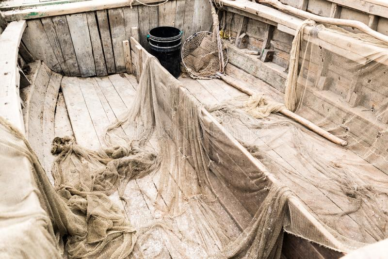 海木纹理 老小船捕鱼 库存图片