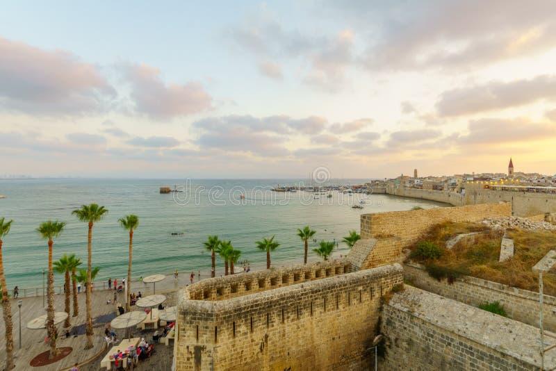 海滩、防波堤和口岸,英亩的日落视图 免版税库存照片
